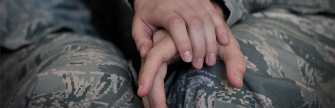 Two airmen holding holding hands