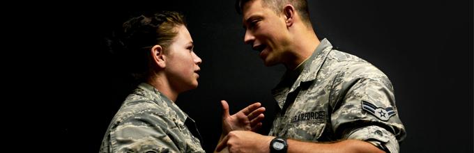 Two airmen talking.