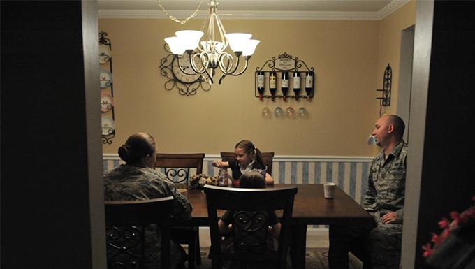 A family having dinner at the dinner table.