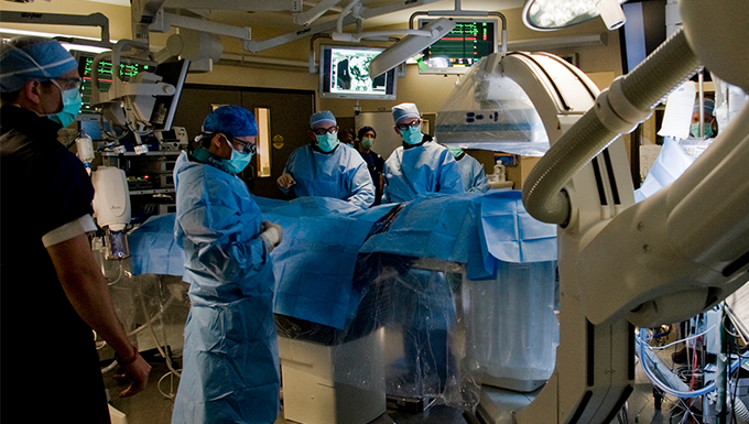 A group of doctor's performing vascular surgery.