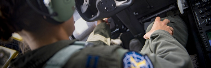 Image of an Airman in the cockpit of an aircraft