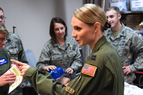 An Air Force captain pointing in front of a group of other airmen.