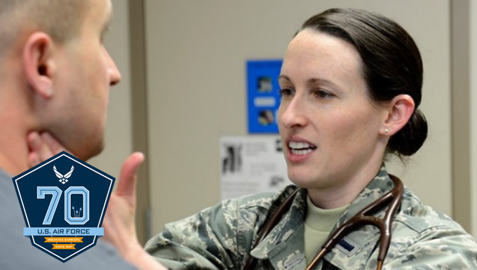 An airman getting his throat checked.