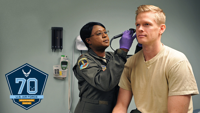 An airman getting his ears checked.