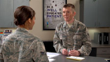 Image of two Airmen talking in an office