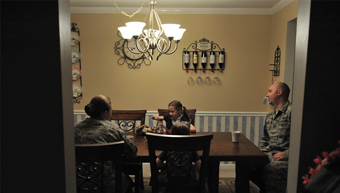 A family having dinner at the dinner table.
