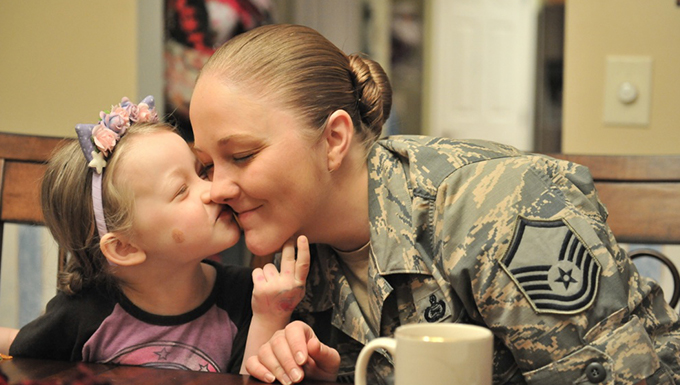 A child kissing her mother.