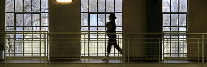 Image of an Airman running indoors